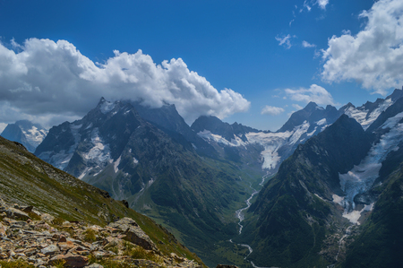 glaciers: Mountain peaks, glaciers and valleys at Dombay region, Western Caucasus Stock Photo