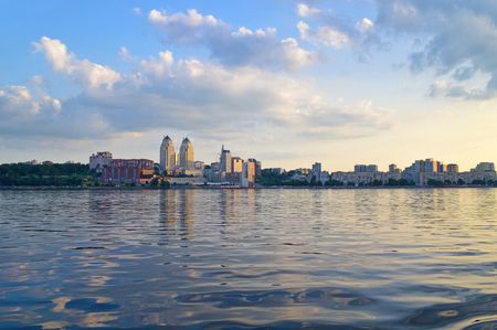 dnieper: Panoramic view of Dnipropetrovsk city from Dnieper river. Early evening view of Dnipro city. Dnepropetrovsk city skyline.