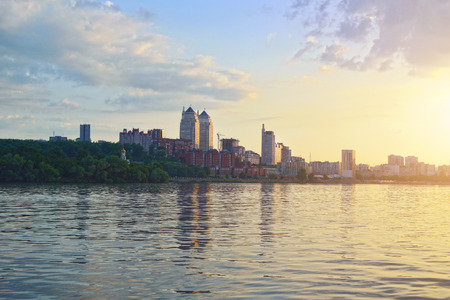 Panoramic view of Dnipropetrovsk city from Dnieper river. Early evening view of Dnipro city. Dnepropetrovsk city skyline at sunset. Stock Photo