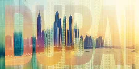Dubai Marina skyline at sunset, United Arab Emirates. Digital collage of skyscrapers placed inside Dubai lettering Stock Photo