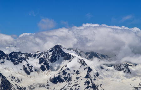 Panoramic view on Caucasus Mountain Range. Rocks and glaciers in Elbrus mountain region Stock Photo