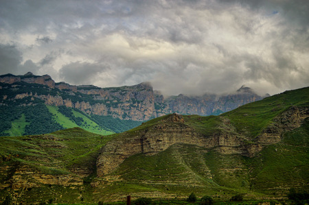 Dramatic clouds over the picturesque mountain canyon in Western Caucasus.