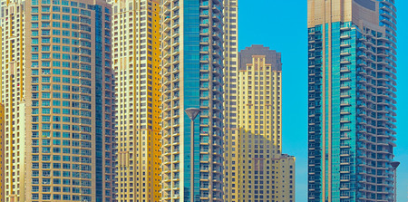Abstract fragment of modern architecture. Skyscrapers of Dubai Stock Photo