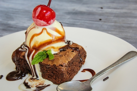 Chocolate Brownie sundae with vanilla ice cream and cherry Stock Photo