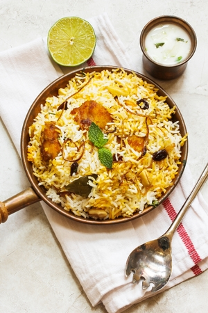 non vegetarian: Fish Biryani Indian style fish and rice with spicy masala and color