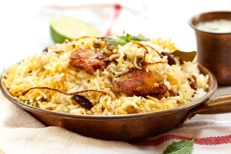 peces: pescados del estilo de pescado Biryani indio y arroz con picante masala y color Foto de archivo