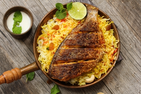 food fish: Fish Biryani Indian style fish and rice with spicy masala and color