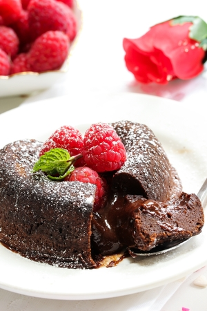 Chocolate Lava Cake Heart shaped with raspberry for Valentines day Stock fotó