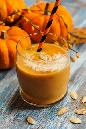 dynia: Pumpkin smoothie health drink with spices for winter and  thanksgiving halloween