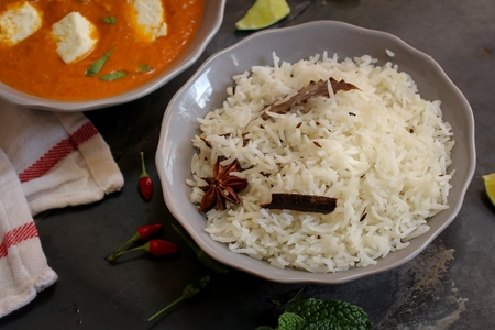 paneer: Paneer Butter masala and cooked rice Indian Curry vegetarian Dinner Stock Photo