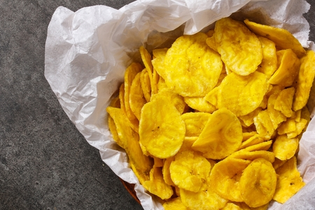 plantain: Plantain Banana Chips  fried in oil close up view