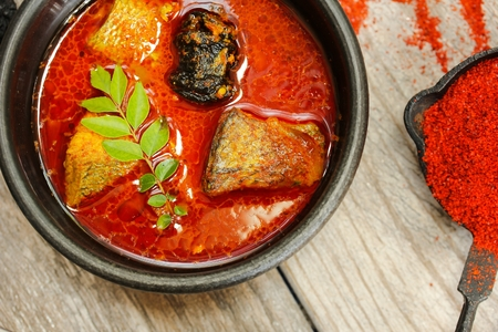 kerala culture: Spicy Indian Fish curry in coconut milk top view