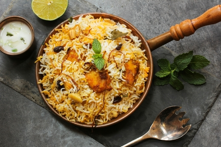 arroz: Fish Biryani made with basmati rice Famous Indian and middle eastern food