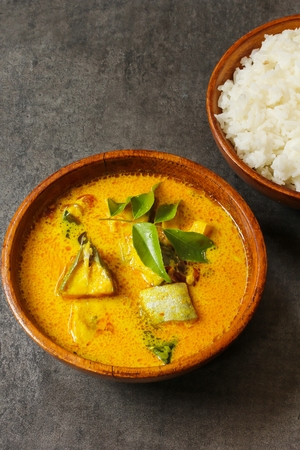 molly: Spicy Indian Fish curry in coconut milktop view