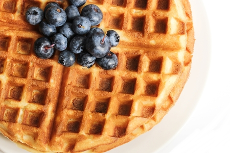 Warm Waffle Breakfast with blueberries  made in a home kitchen
