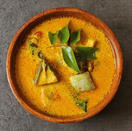Spicy Indian Fish curry in coconut milktop view