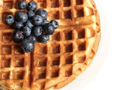 Warm Waffle Breakfast with blueberries  made in a home kitchen 版權商用圖片 - 54724842