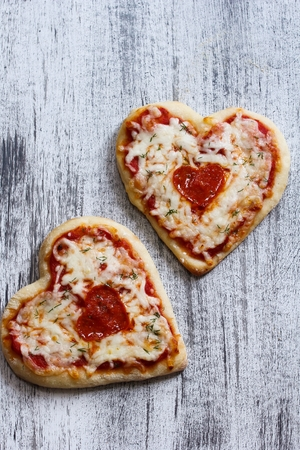 shaped: Two Heart Shaped Pizza for Valentines Day Background