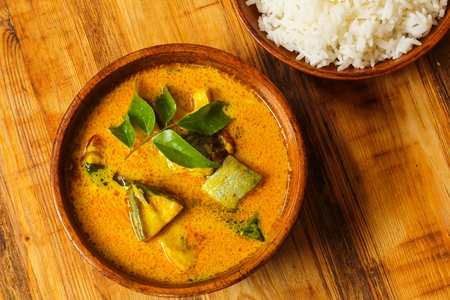 molly: Spicy Indian Fish curry in coconut milk top view