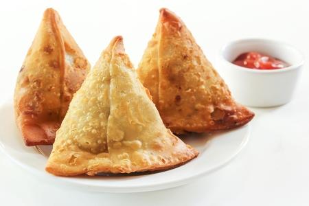 Samosa Indian snack fried food on white background