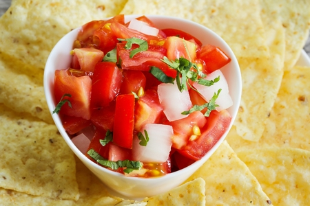 chips and salsa: Tomato Salsa and Tortilla Corn Chips close up view Stock Photo