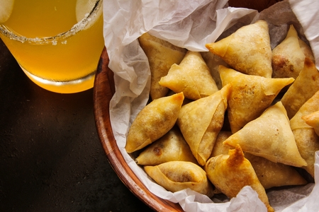 fried food: Small Cocktail Samosas Indian snack fried food Stock Photo