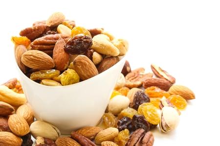 Assorted mix of dry fruits and Nuts almond,cashew, peanut,raisin and walnut in white bowl Zdjęcie Seryjne
