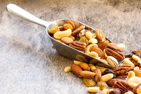 Assorted mix of dry fruits and Nuts almond,cashew, peanut,raisin and walnut with wooden background