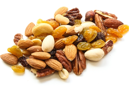 pista: Assorted mix of dry fruits and Nuts almond,cashew, peanut,raisin and walnut in white background Stock Photo