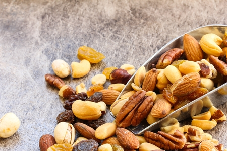 pista: Assorted mix of dry fruits and Nuts almond,cashew, peanut,raisin and walnut with wooden background