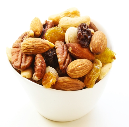 Assorted mix of dry fruits and Nuts almond,cashew, peanut,raisin and walnut in white bowl 写真素材