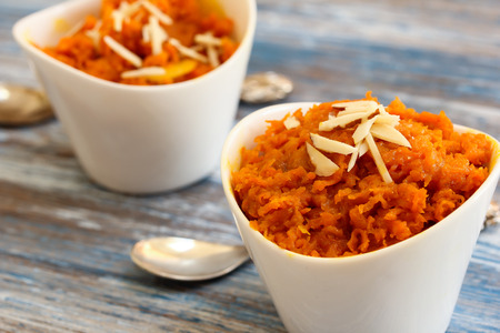 Carrot halwa - Diwali sweet made of carrots milk and sugar in white bowl