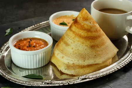 dosa: Cone shape Masala Dosa with Sambar and chutney, south Indian breakfast