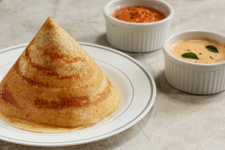 dosa: Cone shape Dosa with chutney, south Indian breakfast