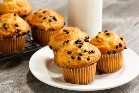 Chocolate chip Breakfast muffins close up on white plate
