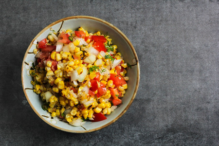 Homemade Grilled corn salsa overhead view Stock Photo