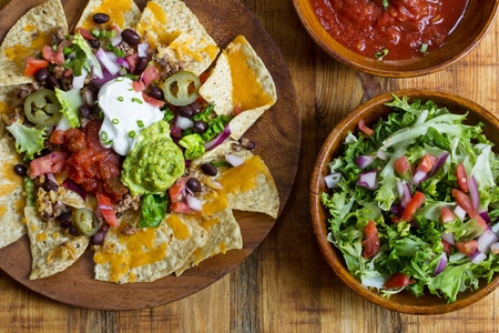 nacho: Nacho Cheese Tortilla chips with chili ,salsa ,sour cream and guacamole