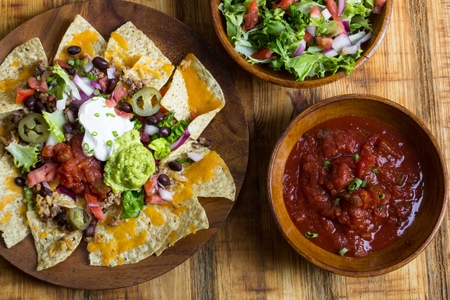 chips and salsa: Nacho Cheese Tortilla chips with chili ,salsa ,sour cream and guacamole