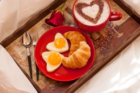 Valentines day breakfast Croissant Eggs and Coffee on tray