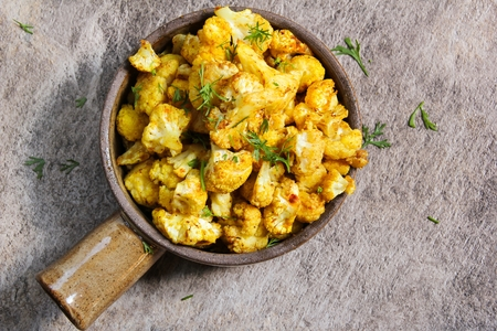 Healthy food - Oven Roasted Cauliflower in ceramic pot Stock Photo