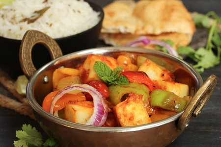 Kadai Paneer served with ZJeera rice and Bhatura  Indian Vegetarian meal