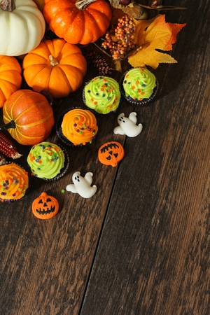 Halloween Background  Autumn background with pumpkins and Halloween treats Stock Photo