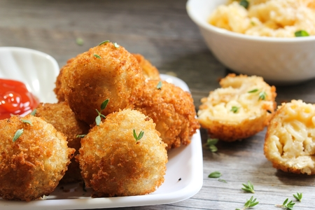 Fried Mac and Cheese balls served with ketch up, selective focus