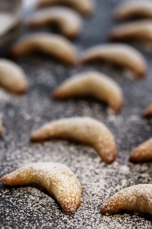 moody background: Almond Crescent cookies on dark moody background, selective focus Stock Photo