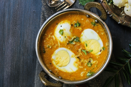 Indian Kolhapuri egg Curry / Egg Masala - Hard boiled eggs cooked in aromatic spices and served in a Kadai overhead view