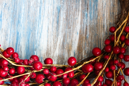 red berries: Red Berries on blue wooden background with copy space, selective focus Stock Photo