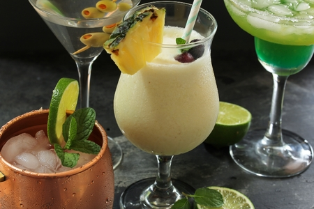 Summer drinks / Cocktails -Moscow Mule,Pina Colada ,Martini and Lime cocktail in one frame, selective focus