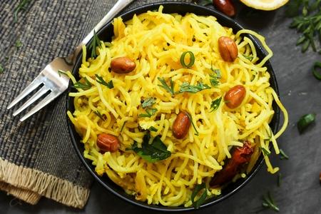 south indian: Lemon Sevai  Idiyappam Upma   Lemon Rice Noodles- South Indian breakfast with leftover Idiyappam Stock Photo