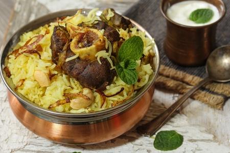 Lamb Biryani  Mutton Biryaniserved with Yogurt dip, selective focus
