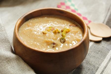 Vermicelli pudding  Semiya Kheer served ins wooden bowl, selective focus
